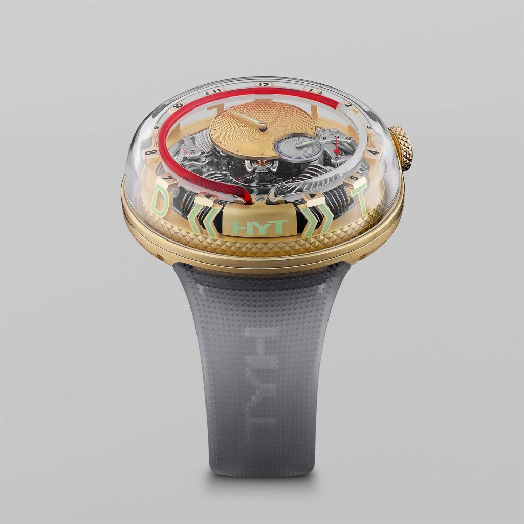 HYT H2.0 Time Is Fluid Gold FrontView blog debajo del reloj